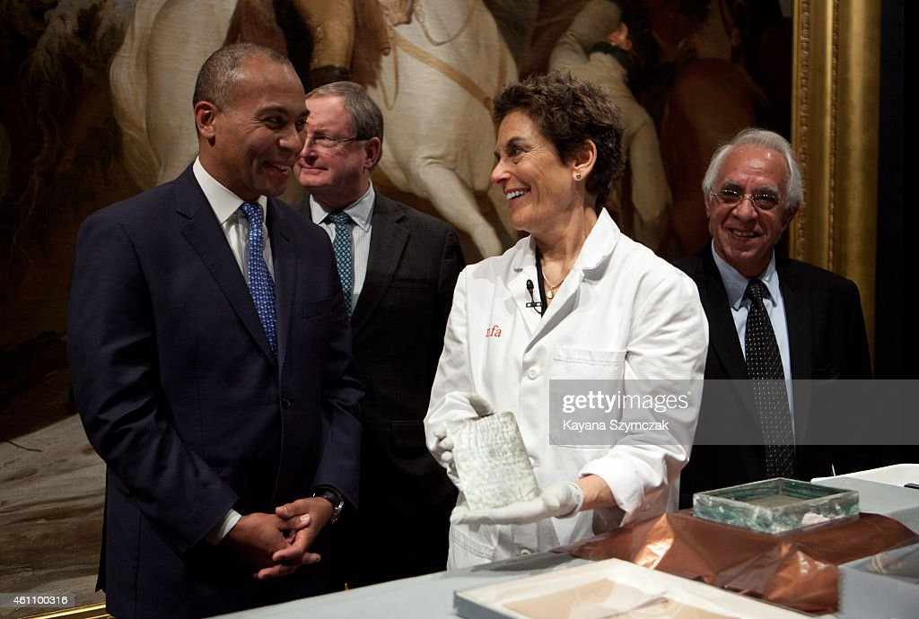 Massachusetts Governor Deval Patrick speaks with Pam Hatchfield Head of Objects Conservation at the Museum of Fine Arts Boston as she displays a...