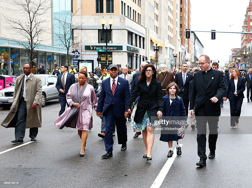 Massachusetts Governor Deval Patrick walks with his wife Diane and members of the victims families during a wreathlaying ceremony commemorating the...