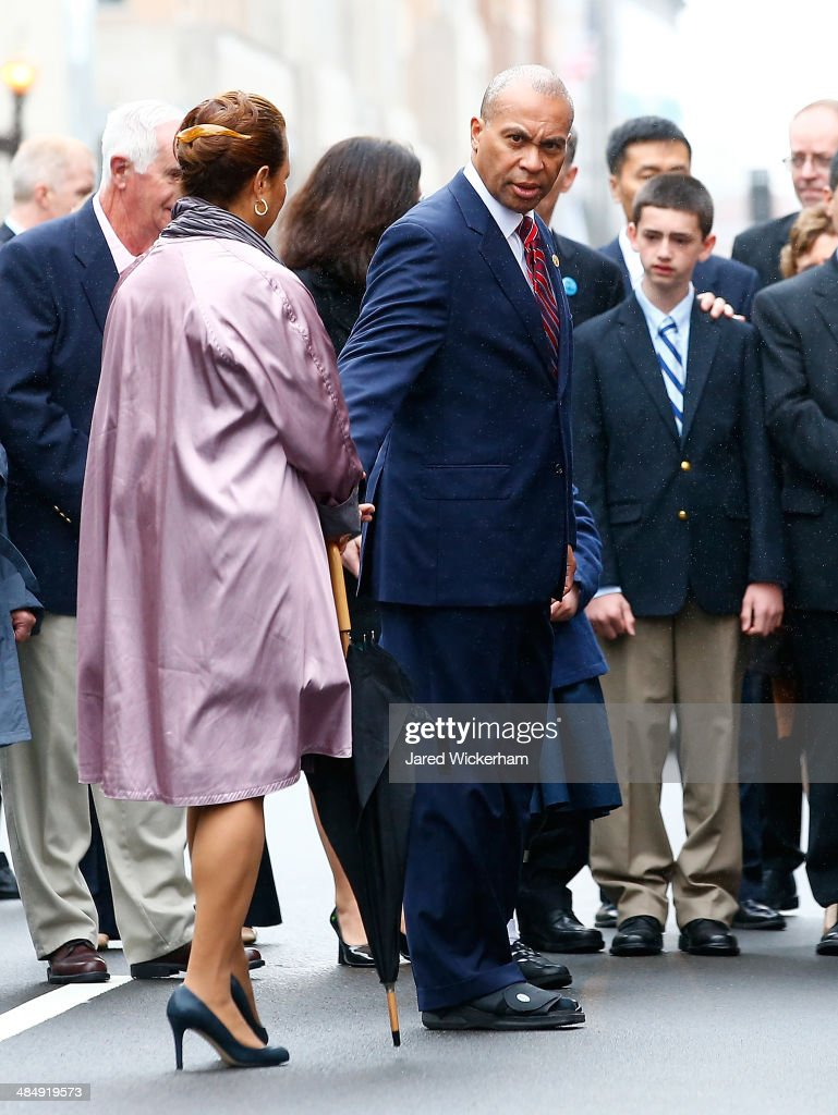Massachusetts Governor Deval Patrick walks with his wife, Diane, and members of the victims families during a wreath-laying ceremony commemorating the one-year anniversary of the Boston Marathon bombings on Boylston Street near the finish line on April 15, 2014 in Boston, Massachusetts. Last year, two pressure cooker bombs killed three and injured an estimated 264 others during the Boston marathon, on April 15, 2013.
