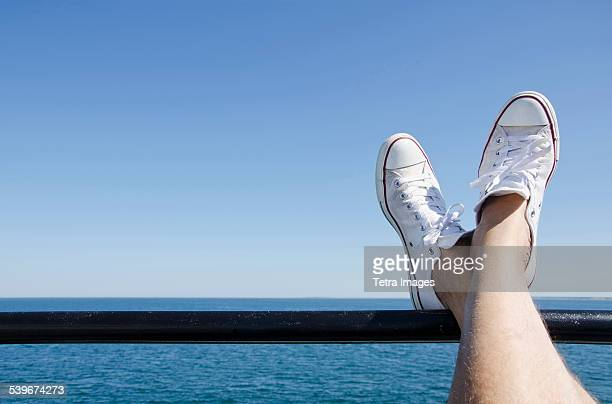 USA, Massachusetts, Mans feet on ferry boat