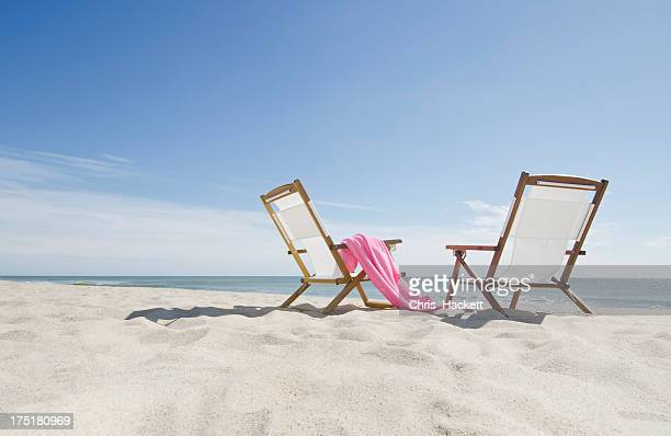 USA, Massachusetts, Nantucket, empty lounge chairs on sandy beach