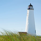 USA, Massachusetts, Nantucket, Great Point Lighthouse against clear sky with marram grass in foreground