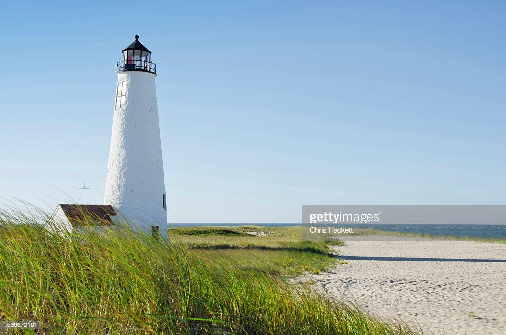 USA, Massachusetts, Nantucket, Great Point Lighthouse on overgrown beach against clear sky
