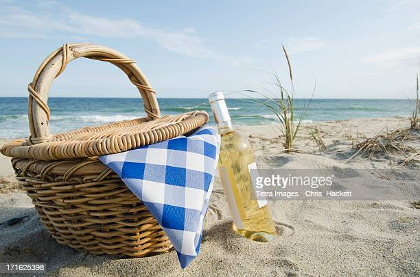 USA, Massachusetts, Nantucket, Nantucket Island, Picnic basket and white wine on beach