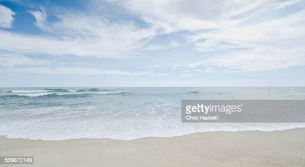 USA, Massachusetts, Nantucket, Seascape with surf on sandy beach