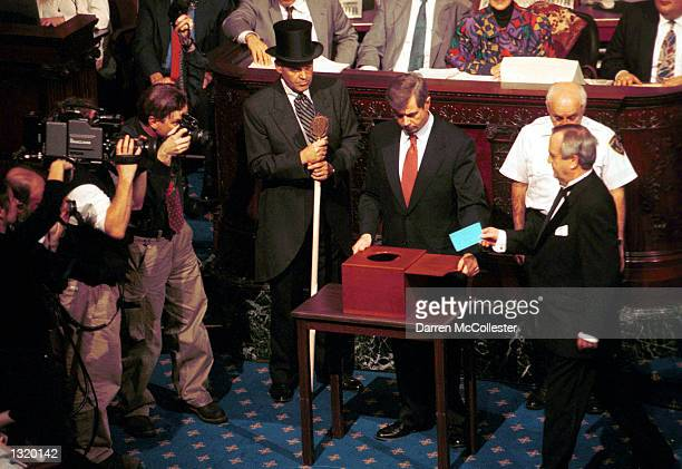 Massachusetts Secretary of State William Galvin opens the ballot box December 18 2000 as Massachusetts Electoral College president Robert E Colt...