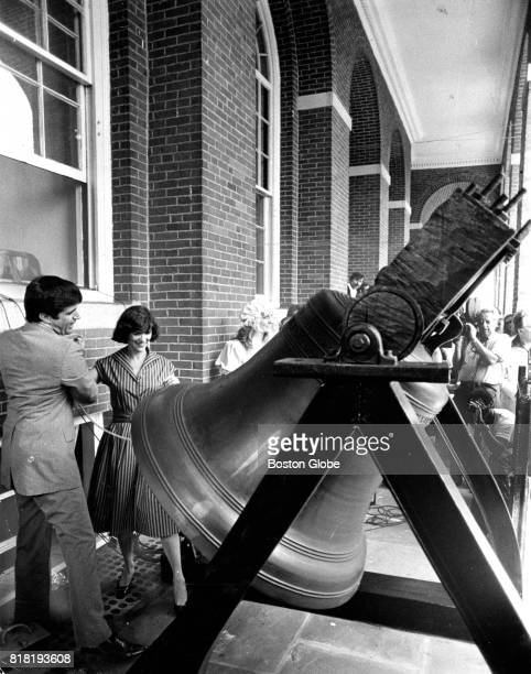 Massachusetts Secretary of the Commonwealth Paul Guzzi left and Kitty Dukakis wife of Governor Michael Dukakis ring the replica of the Liberty Bell...