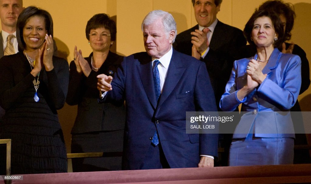 Massachusetts Senator Ted Kennedy (C), alongside his wife, Victoria (R) and First Lady <a gi-track='captionPersonalityLinkClicked' href=/galleries/search?phrase=Michelle+Obama&family=editorial&specificpeople=2528864 ng-click='$event.stopPropagation()'>Michelle Obama</a> (L), points to US President Barack Obama after Obama led a signing of Happy Birthday during a musical birthday salute to Kennedy at the Kennedy Center in Washington, DC, March 8, 2009. AFP PHOTO / Saul LOEB