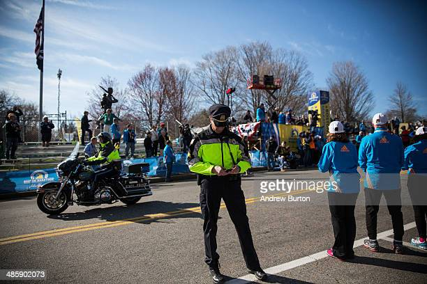 Massachusetts State Police officer stands guard prior to the start of the Boston Marathon on April 21 2014 in Hopkington Massachusetts Today marks...