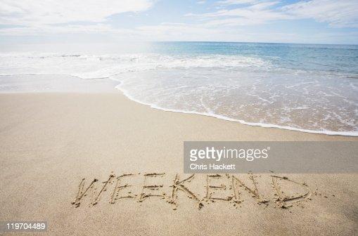 USA, Massachusetts, Word ''weekend'' drawn on sandy beach