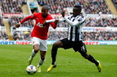 Massadio Haidara of Newcastle in action with Ashley Young of Manchester United during the Barclays Premier League match between Newcastle United and...