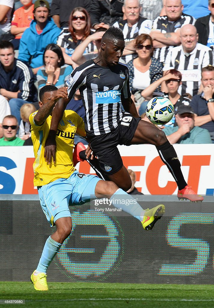 Massadio Haidara of Newcastle United controls the ball under pressure from Jason Puncheon of Crystal Palace during the Barclays Premier League match between Newcastle United and Crystal Palace at St James' Park on August 30, 2014 in Newcastle upon Tyne, England.