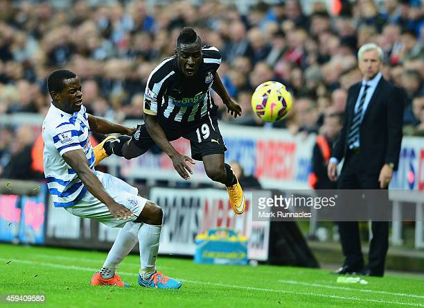 Massadio Haidara of Newcastle United is tackled by Nedum Onuoha of QPR during the Barclays Premier League match between Newcastle United and Queens...