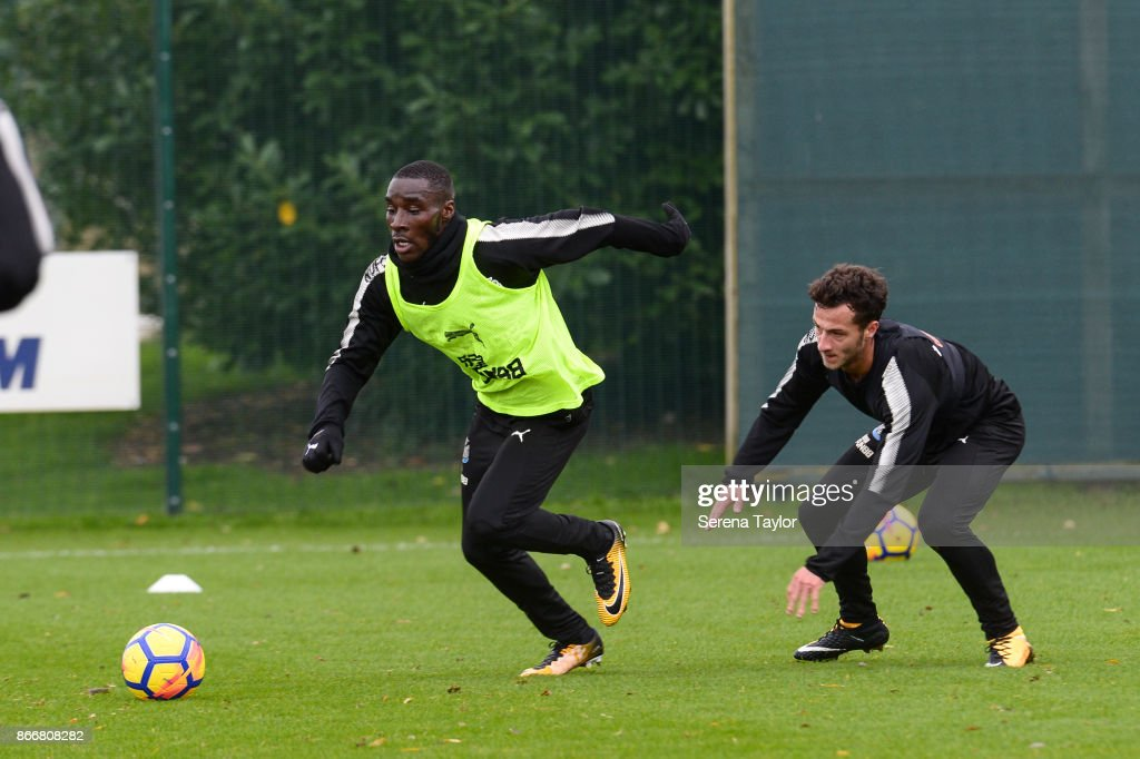 Massadio Haidara (L) runs with the ball during the Newcastle United Training Session at The Newcastle United Training Centre on October 26, 2017, in Newcastle, England.