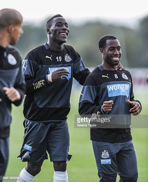 Massadio Haidara smiles with Vurnon Anita during a training session at The Newcastle United Training Centre on September 27 in Newcastle upon Tyne...