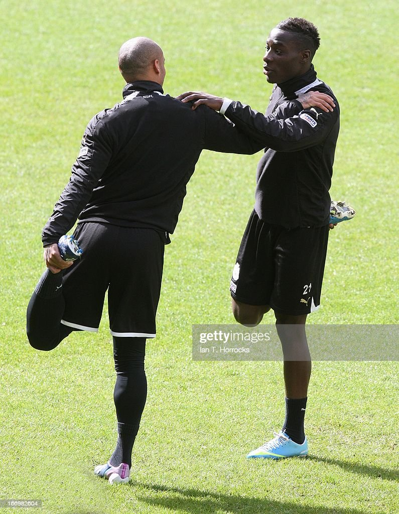 Massadio Haidara (R) stretches during a Newcastle United training session at St James' Park on April 19, in Newcastle upon Tyne, England.