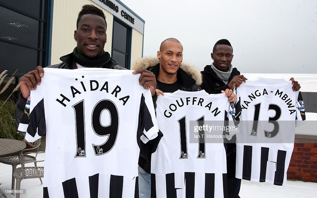 Massadio Haidara, Yoan Gouffran and Mapou Yanga-Mbiwa pose with their shirts after Massadio Haidara signed for Newcastle United on January 24, 2013 in Newcastle upon Tyne, England.