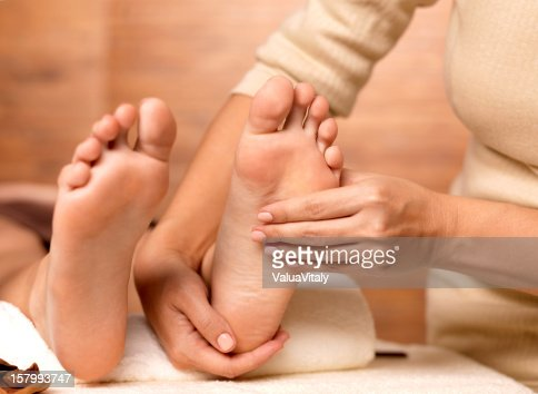 Massage of human foot in spa salon : Stock Photo