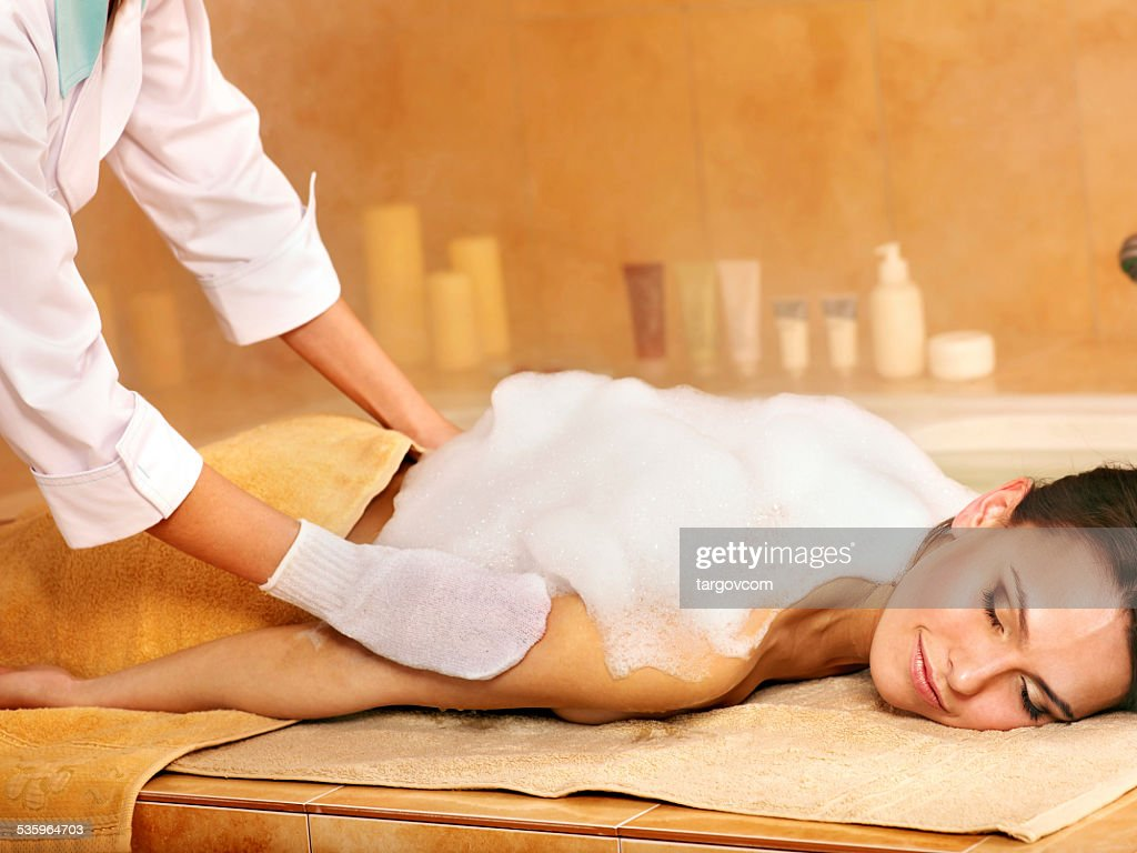 Massage of woman in beauty spa : Stock Photo