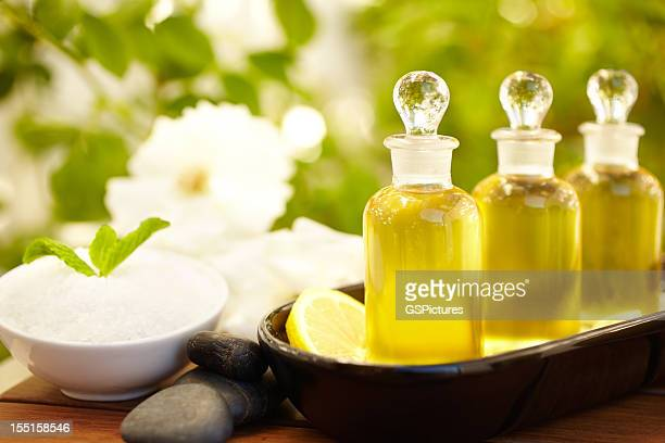 Massage oil bottles and exfoliation scrub at spa