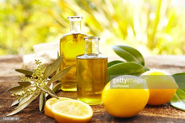 Massage oil bottles at spa outdoors with lemons