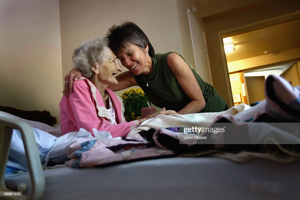 Massage therapist Nikki Hernandez embraces terminally ill patient Jackie Beattie, 83, following a massage at the Hospice of Saint John on August 21, 2009 in Lakewood, Colorado. The non-profit hospice, which serves on average 200 people at a time, is the second oldest hospice in the United States. The hospice accepts patients, regardless of their ability to pay, although most are covered by Medicare or Medicaid. The goal of the center is to maintain quality of life, manage pain, and offer spirutal guidance for residents in the last stage of their lives. End of life care has become a contentious issue in the current national debate on health care reform.