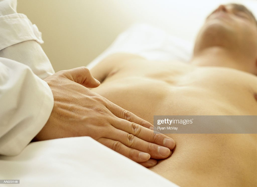 Massage Therapist Palpating the Abdomen : Stock Photo