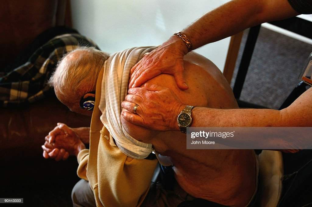 A massage therapist works on the shoulder of terminally ill hospice patient Bob Reschke, 97, at the Hospice of Saint John on September 8, 2009 in Lakewood, Colorado. The non-profit hospice, the second oldest in the United States, accepts the terminally ill regardless of their ability to pay, although most residents are covered by Medicare. End of life care has become a contentious issue in the current national health care debate. The hospice focuses on maintaining quality of life, pain management and spiritual health as the terminally ill approach death.