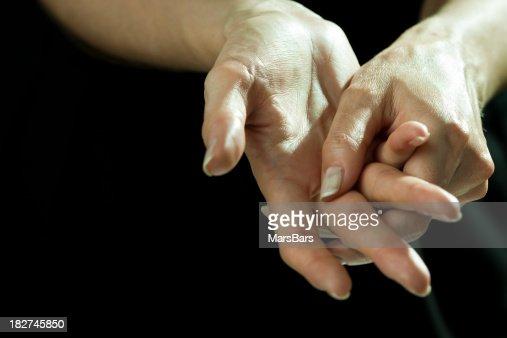 Massaging hands in pain