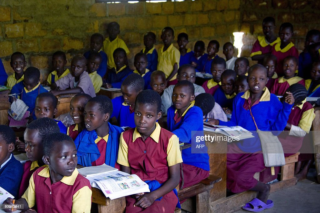 Massai children crowd a classroom in a small Massai village in the western region of Kenya 26 February 2008. The number of students in this school has doubled as newly arrived displaced Massai have been incorporated into this particular Massai community. The Massai community in Western Kenya has seen their long standing dispute with the Kalenjin tribe over land develop into warfare. The post-poll crisis, which has affected the economy, tapped into simmering resentment over land, poverty and the dominance of the Kikuyu, recently re-eleceted President of Kenya Mwai Kibaki's tribe, in Kenyan politics and business since independence. Hundreds of thousands of people have been uprooted, mainly in the capital's slums and fertile western region. AFP PHOTO/Yasuyoshi CHIBA