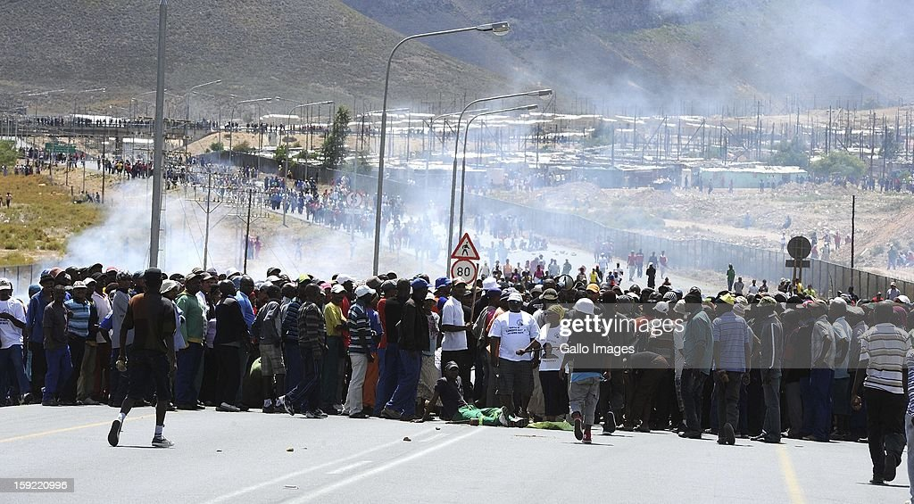 Masses of protestors at the N1 highway De Doorns on January 9, 2013, in Cape Town, South Africa. Protesting farm workers shut down the N1 by lighting tires on fire and placing large rocks on the road.