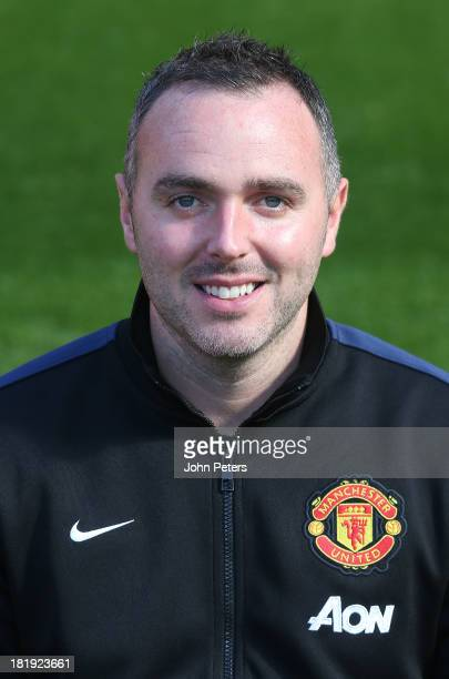 Masseur Andy Caveney of Manchester United poses at the annual club photocall at Old Trafford on September 26 2013 in Manchester England