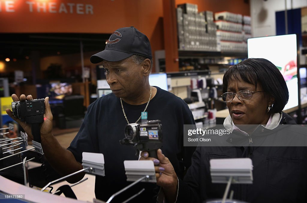 J. D. Massey (L) and Loraine Parker shop for a video camera at a Best Buy store on October 15, 2012 in Chicago, Illinois. Retail sales rose 1.1 percent last month with electronics and appliances leading the way with a 4.5 percent increase in sales.