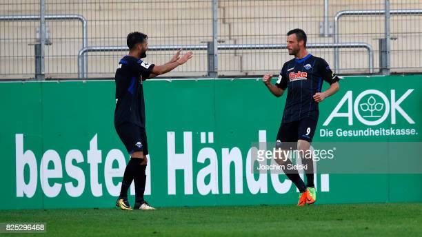 Massih Wassey and Koen van der Biezen of Paderborn celebration the goal 12 for Paderborn during the 3 Liga match between Sportfreunde Lotte and SC...