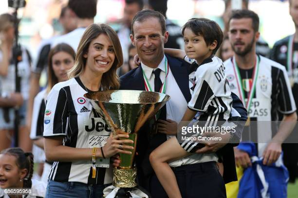Massimiliano Allegri head coach of Juventus FC celebrate the victory of Italian Serie A with championship trophy and his family after the match...