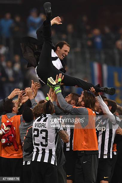 Massimiliano Allegri head coach of Juventus FC is lifted by his players at the end of the Serie A match between UC Sampdoria and Juventus FC at...
