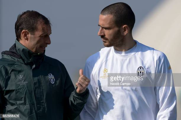 Massimiliano Allegri head coach of Juventus FC speaks with Leonardo Bonucci during the Juventus FC training on the eve of the UEFA Champions League...