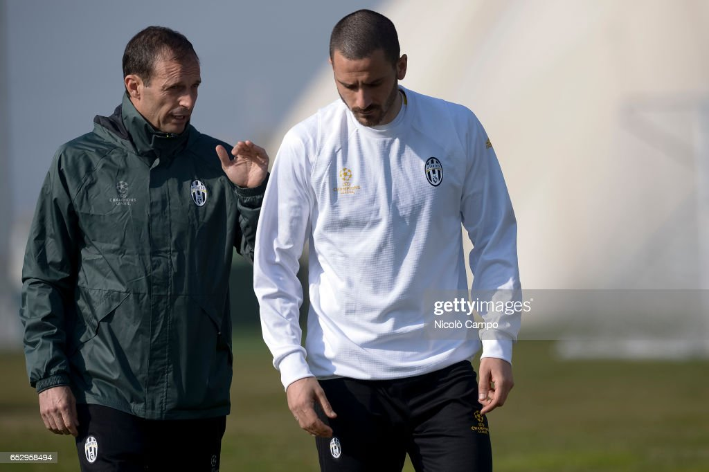 Massimiliano Allegri (left), head coach of Juventus FC, speaks with Leonardo Bonucci during the Juventus FC training on the eve of the UEFA Champions League football match between Juventus FC and FC Porto.