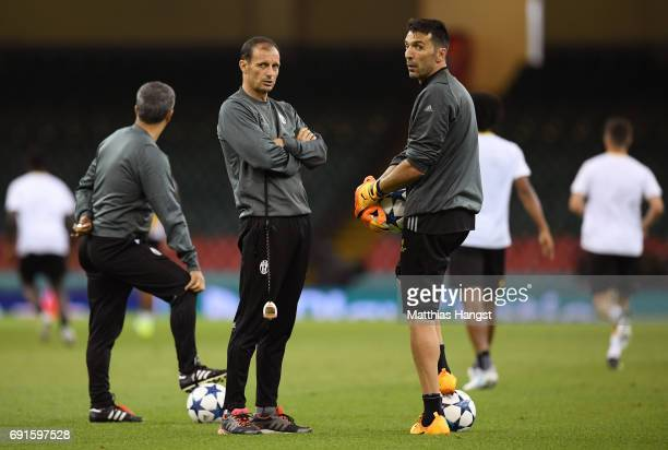 Massimiliano Allegri Manager of Juventus and Gianluigi Buffon of Juventus look on during a Juventus training session prior to the UEFA Champions...