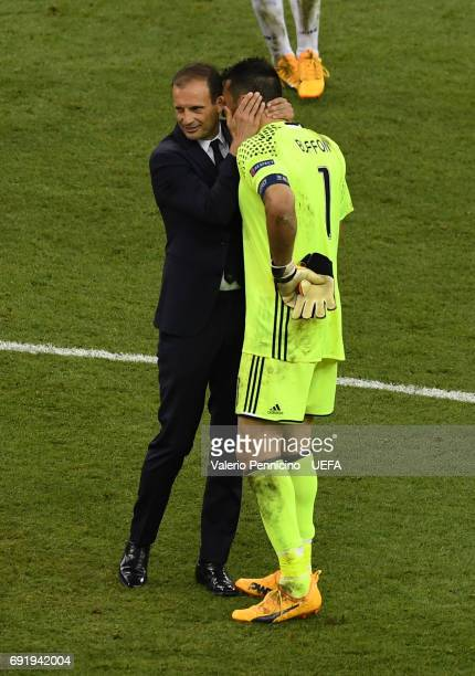 Massimiliano Allegri Manager of Juventus and Gianluigi Buffon of Juventus embrace after the UEFA Champions League Final between Juventus and Real...