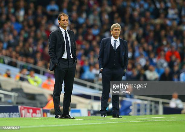 Massimiliano Allegri manager of Juventus and Manuel Pellegrini manager of Manchester City look on from the touchline during the UEFA Champions League...