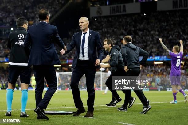 Massimiliano Allegri Manager of Juventus and Zinedine Zidane Manager of Real Madrid shake hands after the UEFA Champions League Final between...