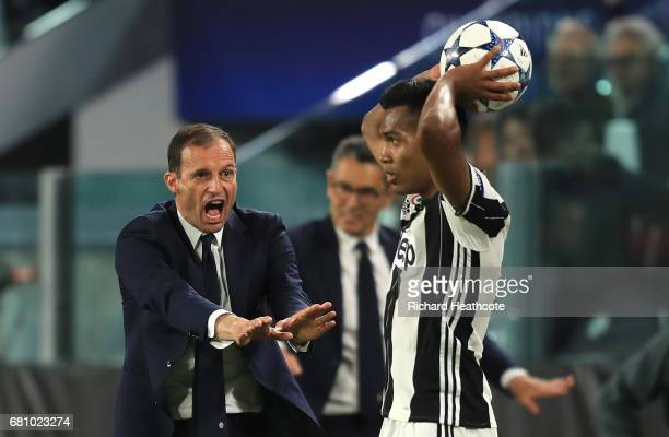 Massimiliano Allegri Manager of Juventus gestures towards Alex Sandro of Juventus during the UEFA Champions League Semi Final second leg match...