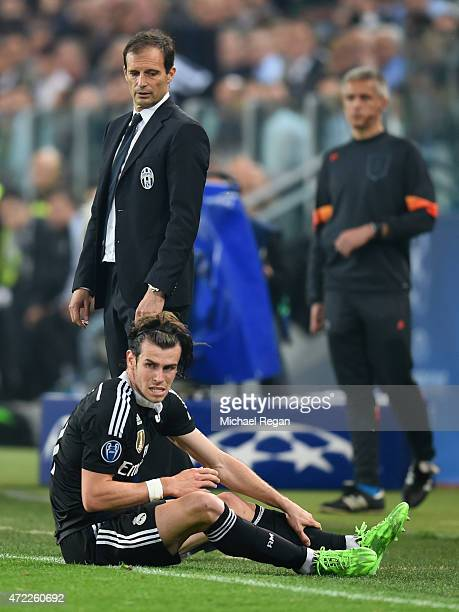 Massimiliano Allegri manager of Juventus looks on as Gareth Bale of Real Madrid CF sits on the touchline during the UEFA Champions League semi final...