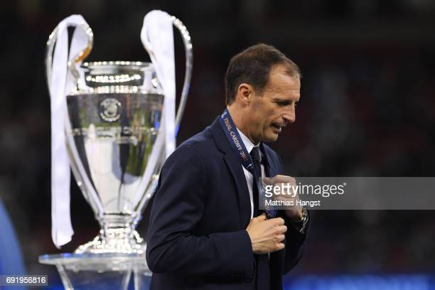 Massimiliano Allegri Manager of Juventus walks past the Champions League trophy after the UEFA Champions League Final between Juventus and Real...