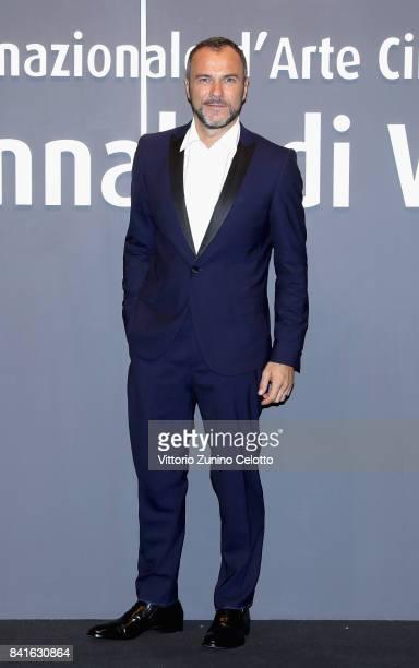 Massimiliano Gallo walks the red carpet ahead of the 'Nato A Casal Di Principe' screening during the 74th Venice Film Festival at Sala Giardino on...