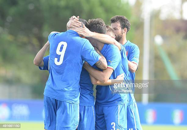 Massimiliano Gatto of Italy U20 is mobbed by team mates after scoring his opening goal during the match between the Italy U20 v Poland U20 the 4...