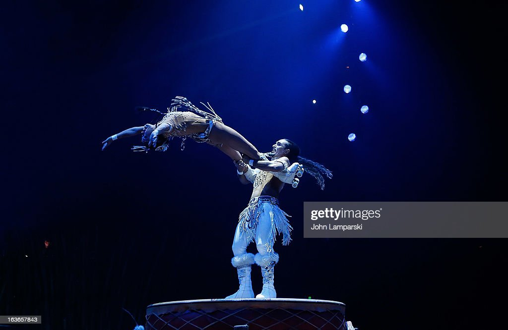 Massimiliano Medini and Denise Garcia Sorta perform during the 'Cirque Du Soleil's Totem' Dress Rehearsal at Citi Field on March 13 2013 in New York...