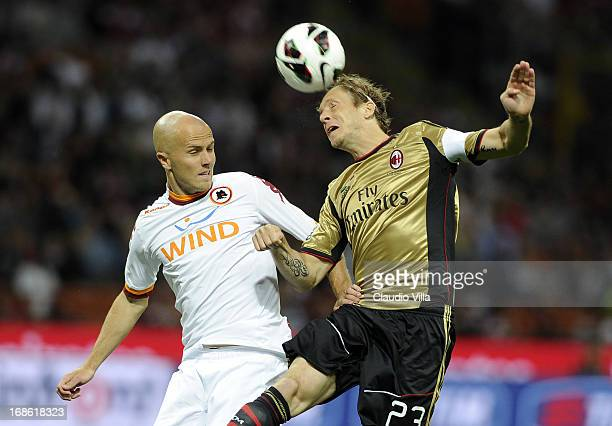 Massimo Ambrosini of AC Milan and Michael Bradley of AS Roma compete for the ball during the Serie A match between AC Milan and AS Roma at San Siro...