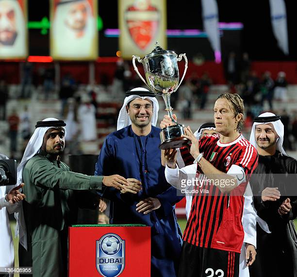 Massimo Ambrosini of AC Milan celebrates with the trophy after the Dubai Challenge Cup match between Paris SaintGermain FC and AC Milan at AlRashid...